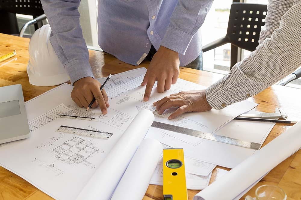 architect pointing at blueprint