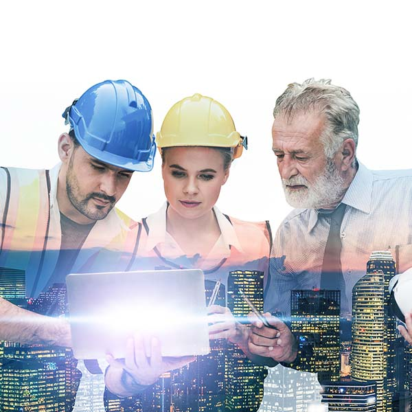Building engineer, architect and construction worker looking at a design